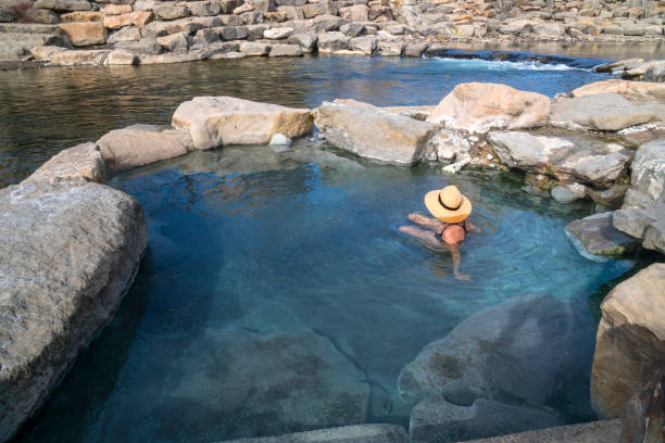 hot spring river pool - hot spring stock photos and pictures