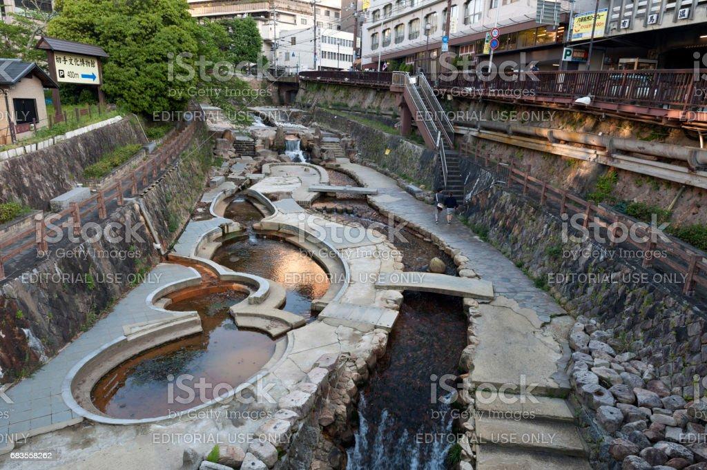 Hot spring stream flowing pass town centre of Arima Onsen in Kita-ku, Kobe, Japan. stock photo