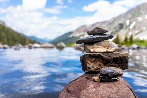 Hot springs pool peak and rock stack cairn on Conundrum Creek Trail in Aspen, Colorado in 2019 summer with view and nobody in USA