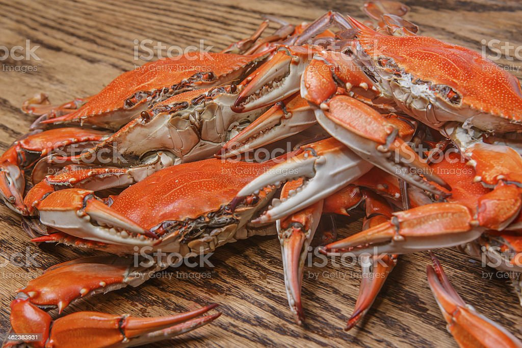 Hot steamed Blue Crabs on a wooden table stock photo