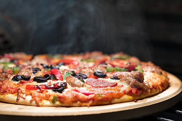 Hot Steaming Pizza in Oven stock photo