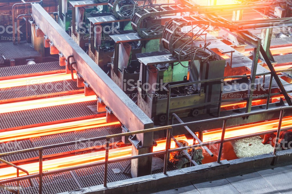 hot steel on conveyor in steel plant stock photo