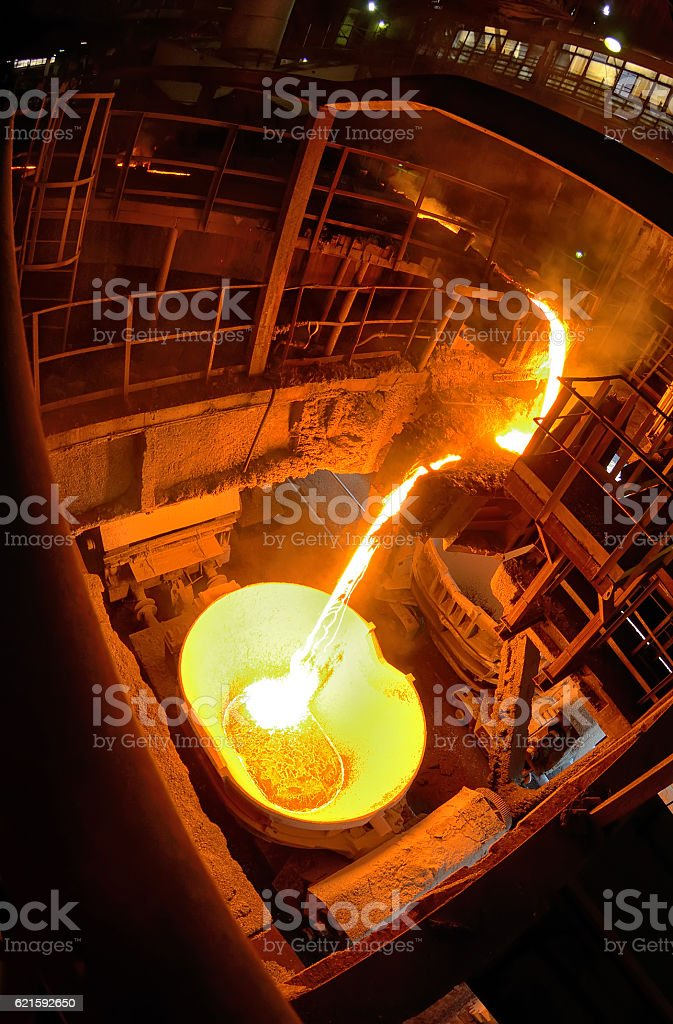 Hot steel pouring in steel plant stock photo