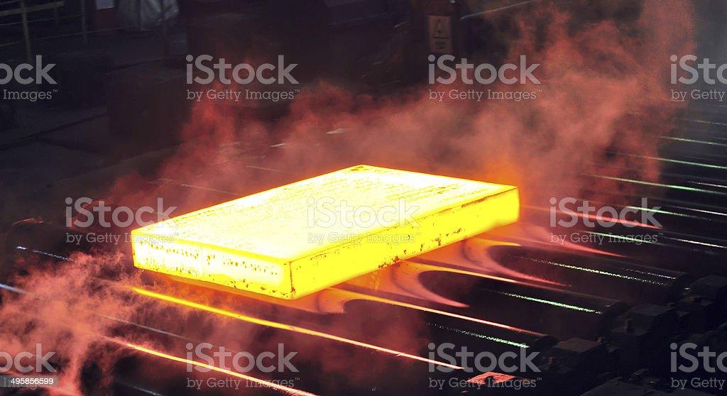 hot steel sheet on conveyor stock photo