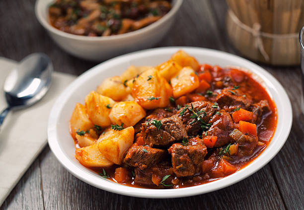 Hot stew with mushrooms and potatoes Hot stew with mushrooms and potatoes beef stew stock pictures, royalty-free photos & images