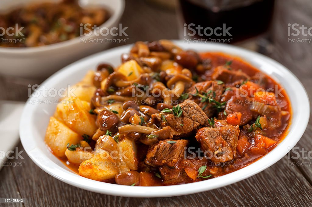 Hot stew with mushrooms and potatoes stock photo