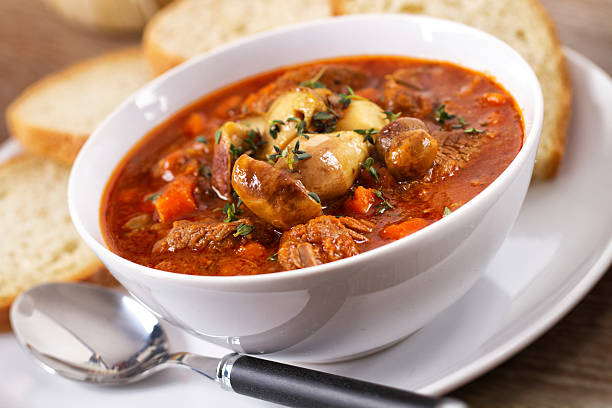 Hot stew with mushrooms Hot stew with mushrooms goulash stock pictures, royalty-free photos & images