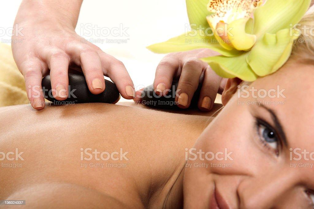 Hot stone massage stock photo