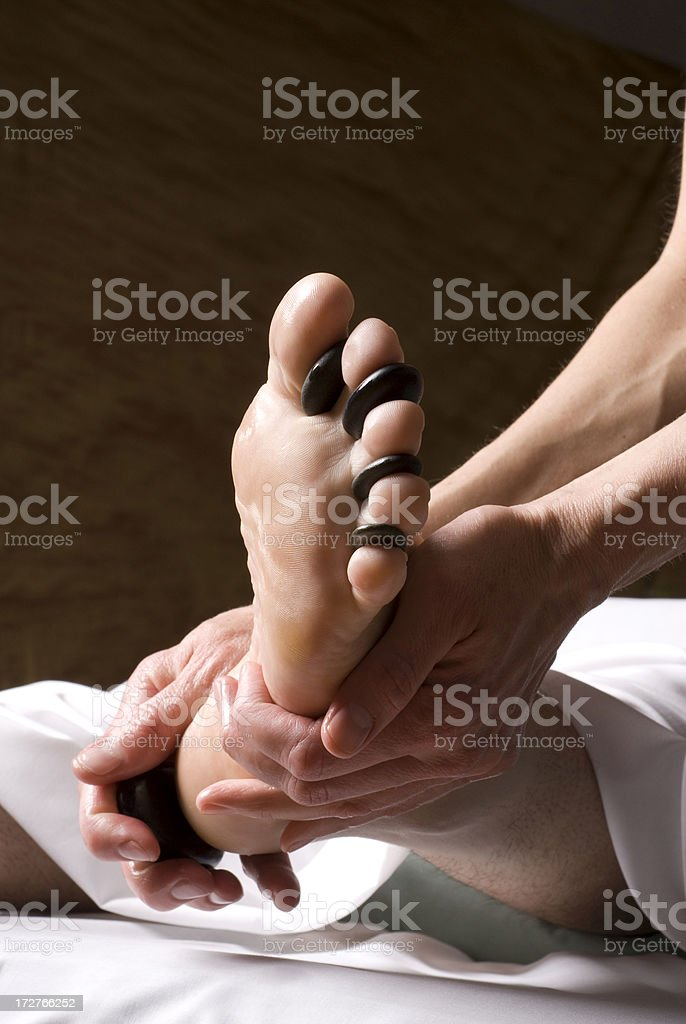 Hot Stone Reflexology Foot Massage II royalty-free stock photo