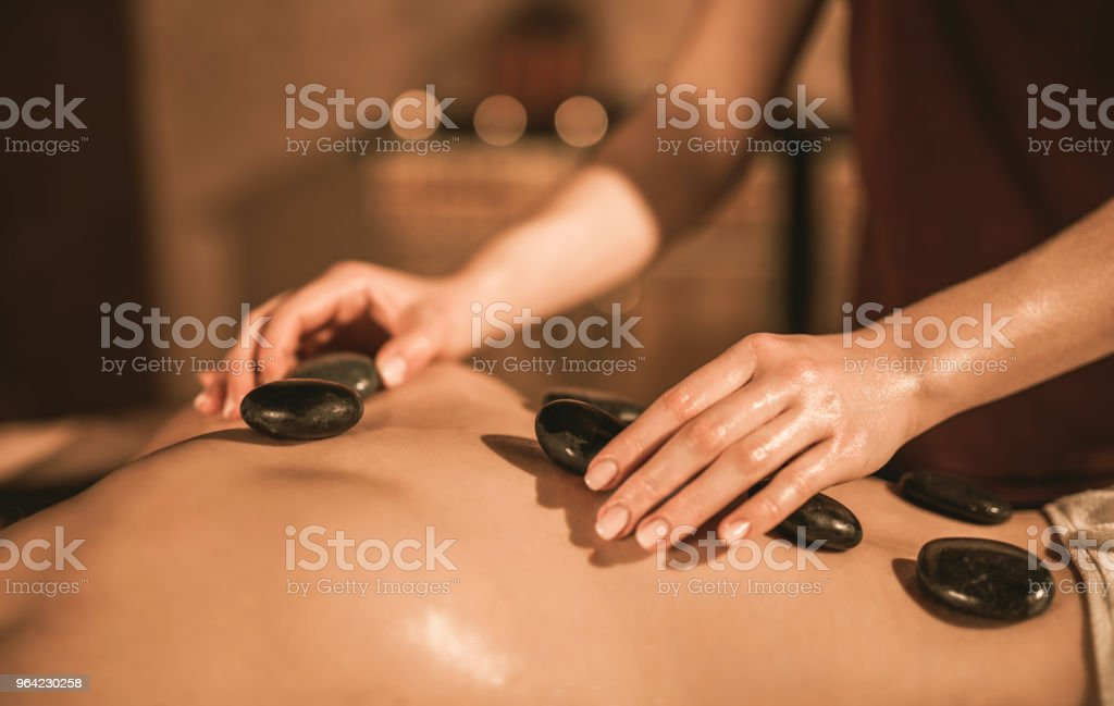 Hot stone therapy close-up. stock photo