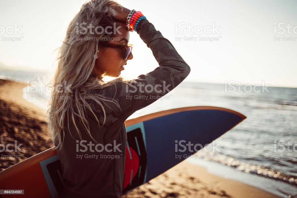 Hot sufer girl with long hair stock photo