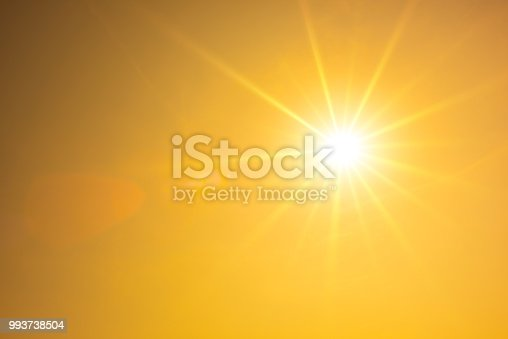Summer background, orange sky with glowing sun