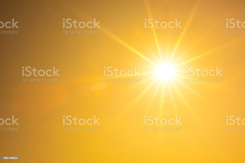Hot summer or heat wave background, orange sky with glowing sun stock photo