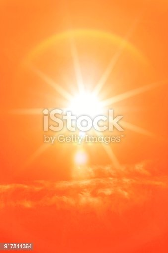 istock Hot summer sun in the sky (toned in orange) 917844364