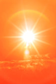 Bright sun with beautiful beams in an orange sky. Space for copy. High resolution - 50 megapixels.