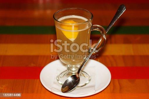 Hot sweet ginger tea with lemon, served in kafe in winter