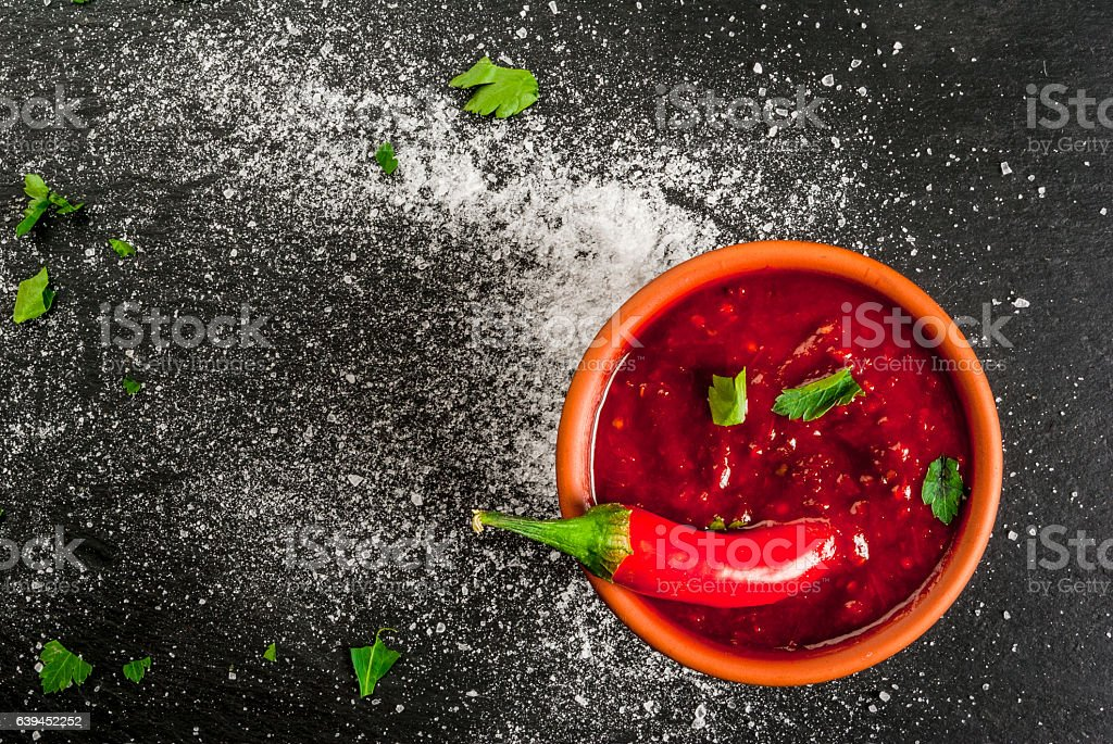 Hot Tabasco sauce in a bowl stock photo