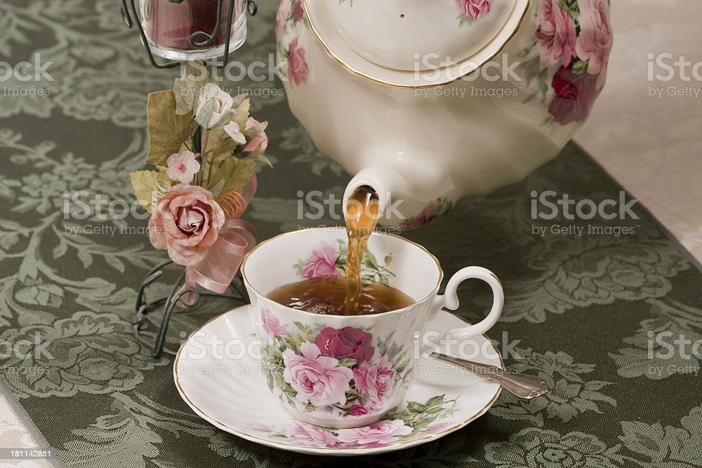 Hot tea being poured into a cup royalty-free stock photo