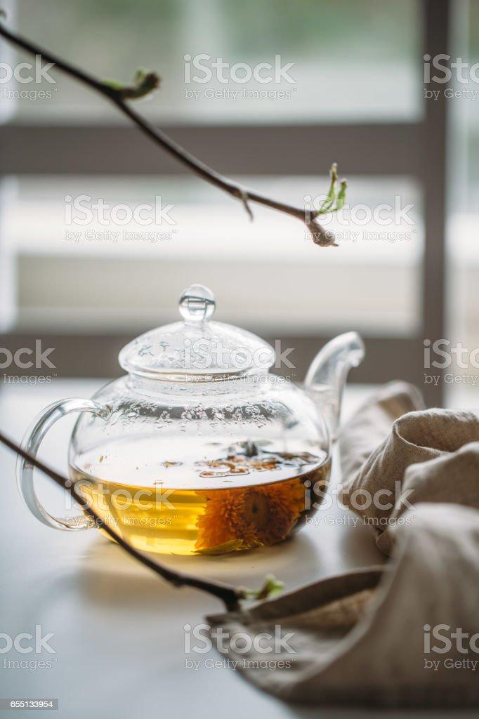Hot tea in glass teapot stock photo