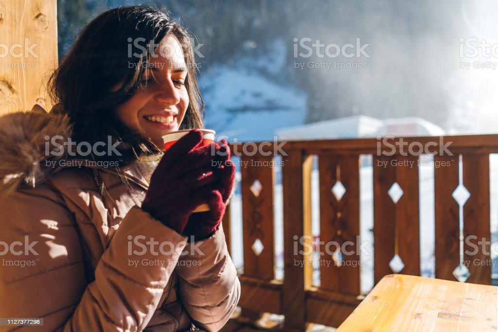 Hot tea in ski resort stock photo
