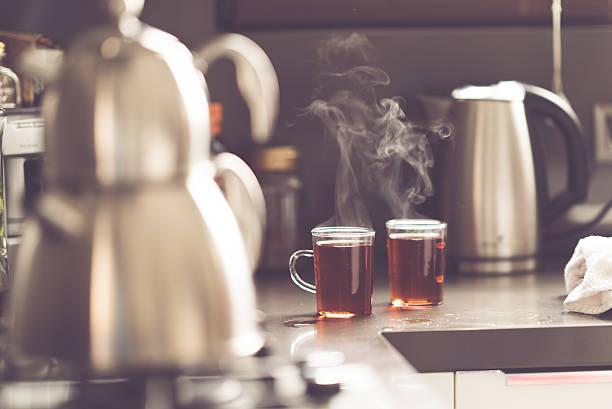 hot tea in the morning - teeladen stock-fotos und bilder