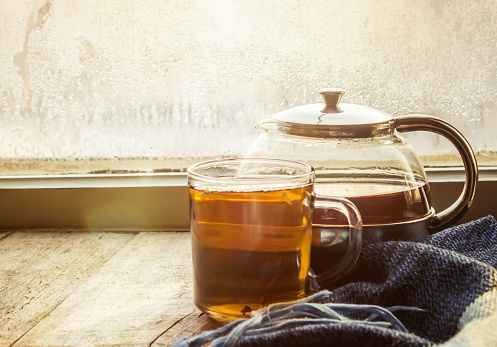 hot tea in the pot near the window. selective focus.