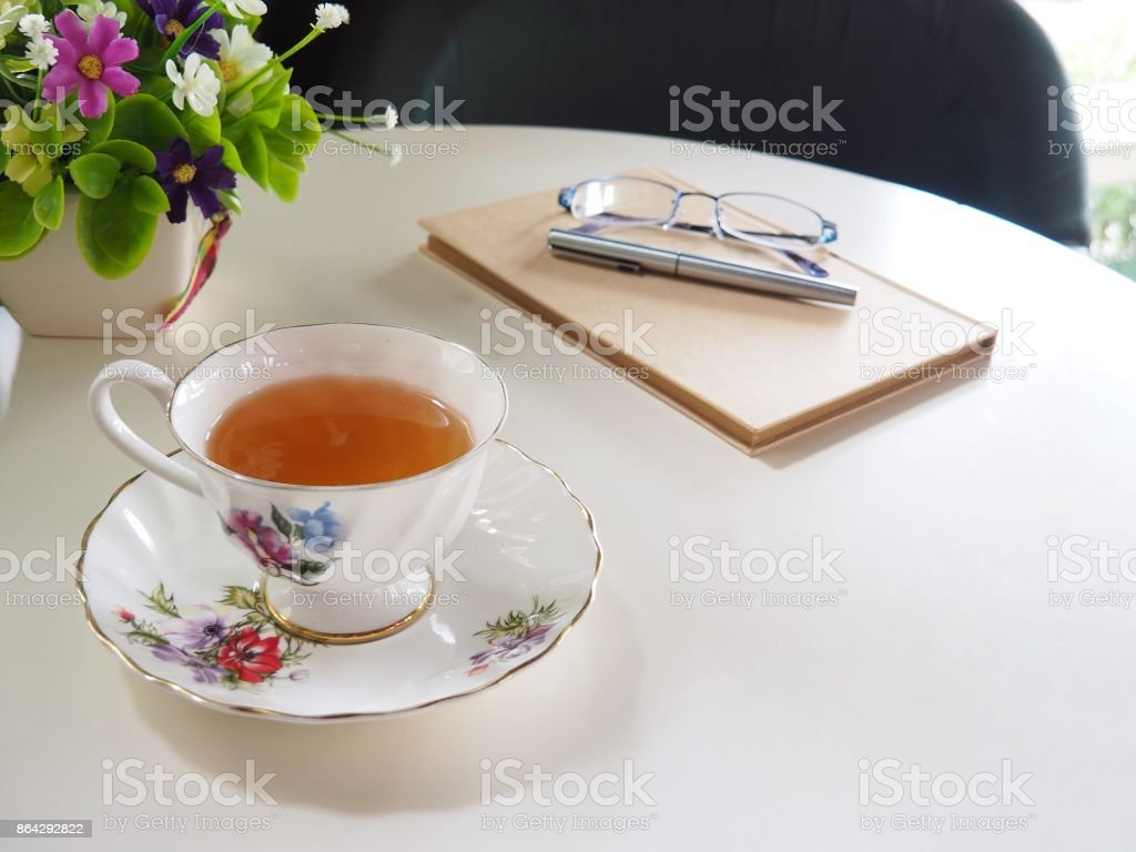 Hot tea, notebook and pen royalty-free stock photo