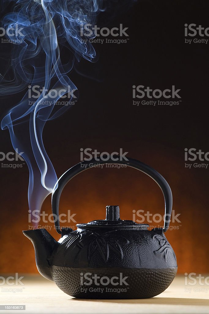 Hot Tea Pot with Steam royalty-free stock photo