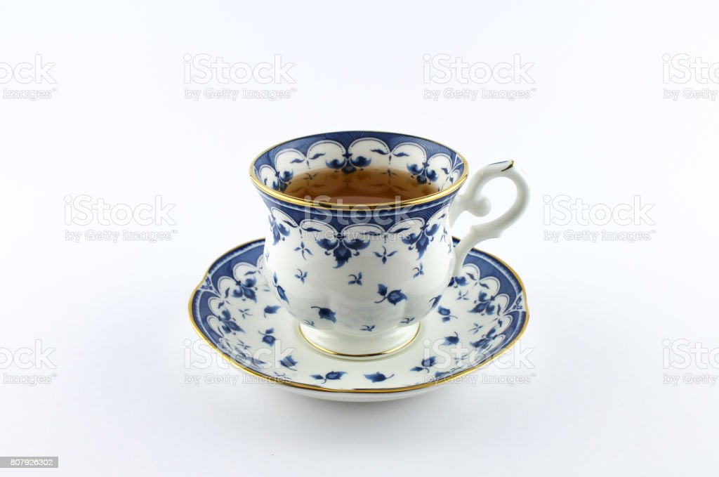 Hot tea served in a beautiful porcelain cup stock photo