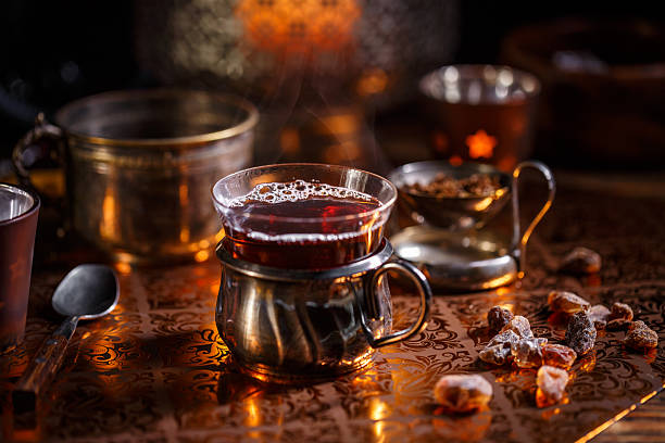 Hot tea with candle - foto stock