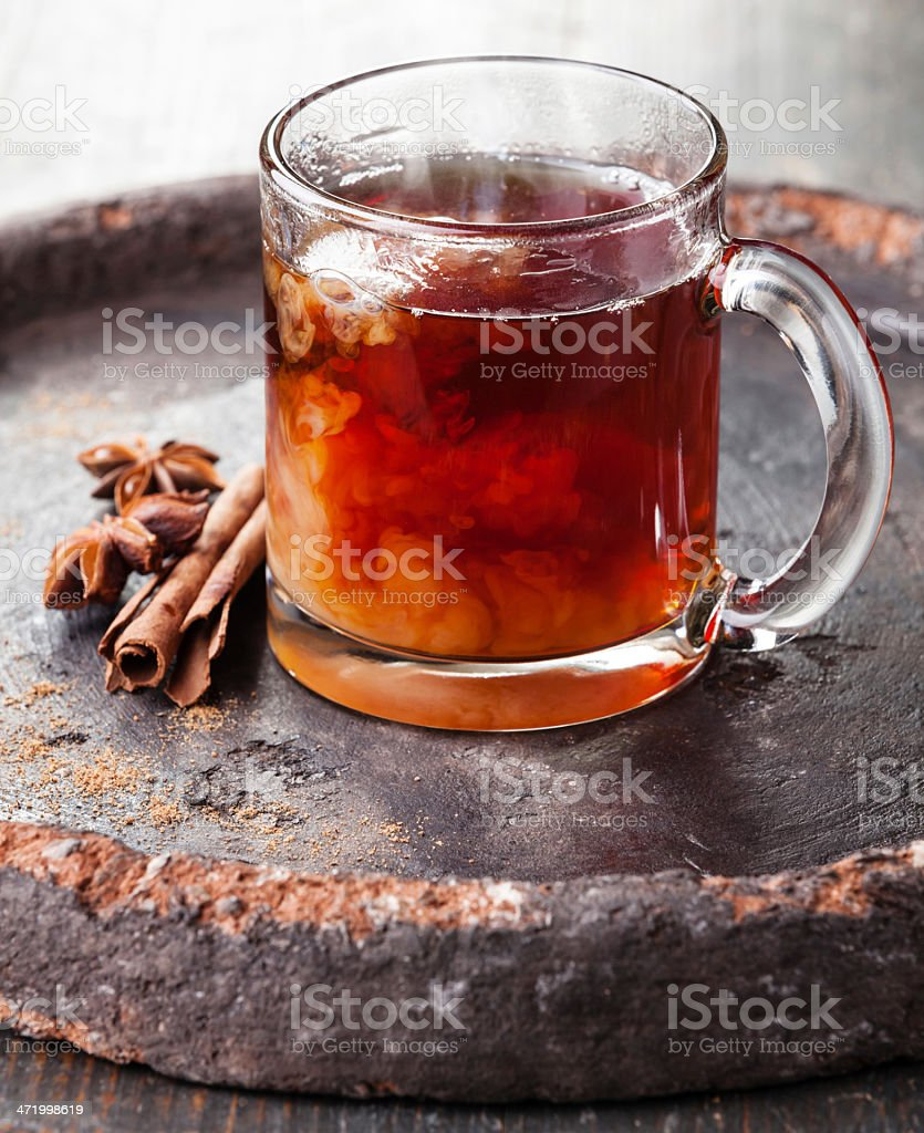 Hot tea with milk and spices stock photo