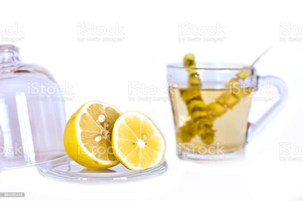 Hot tea with sage and lemon in the glass mug. royalty-free stock photo