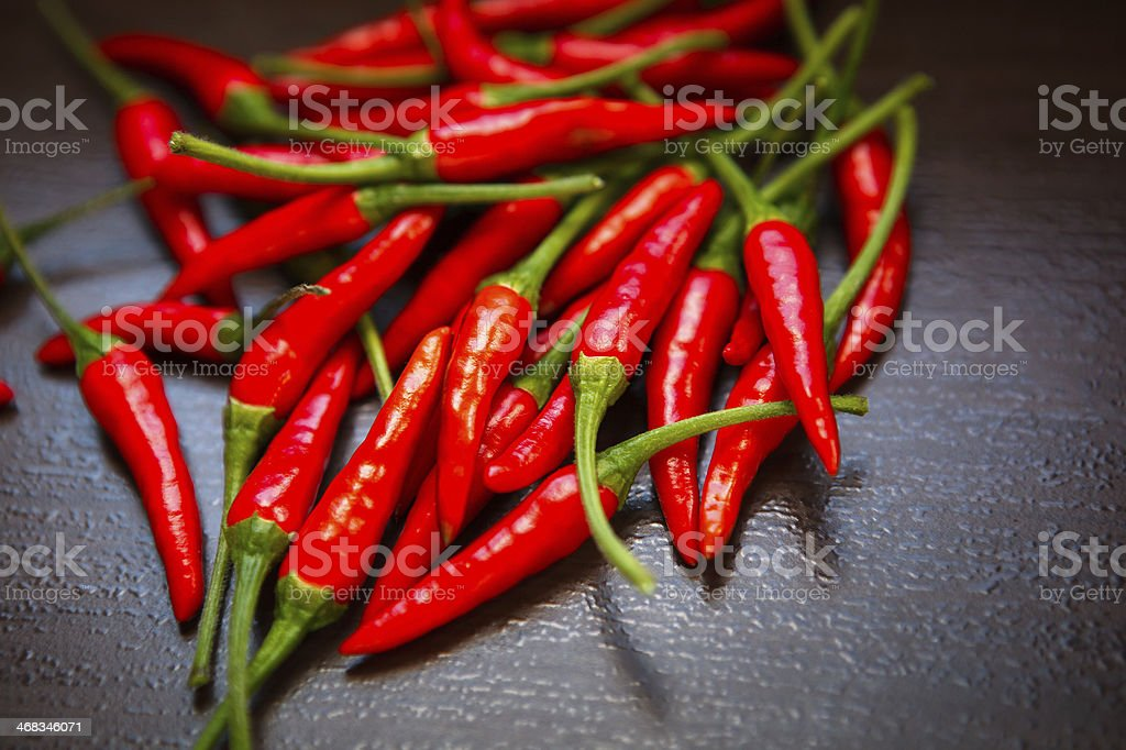 Hot Thai Red Chili Peppers on table stock photo