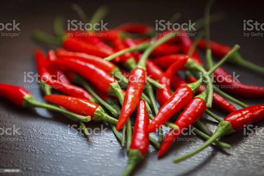 Hot Thai Red Chili Peppers on table royalty-free stock photo
