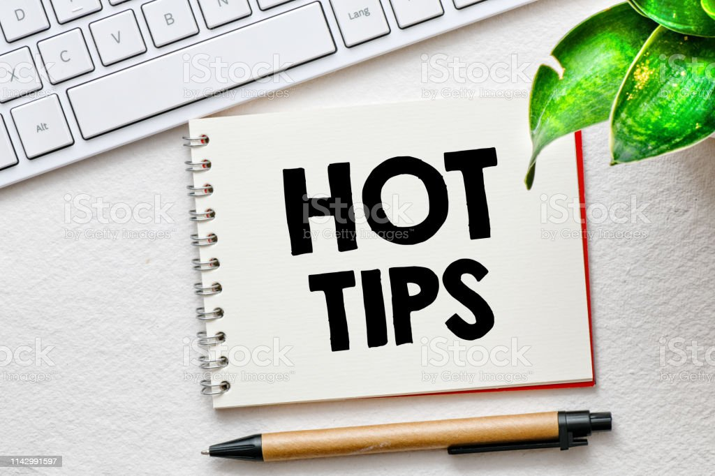 Hot tips text in a notebook stock photo