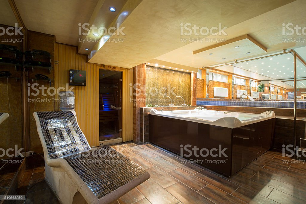 Jacuzzi and hot stone chair in a spa center stock photo