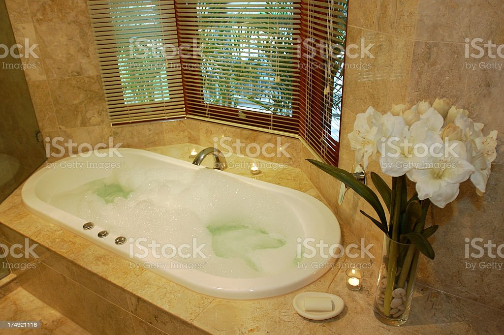 Jacuzzi Spa Bath In Marble Bathroom stock photo | iStock