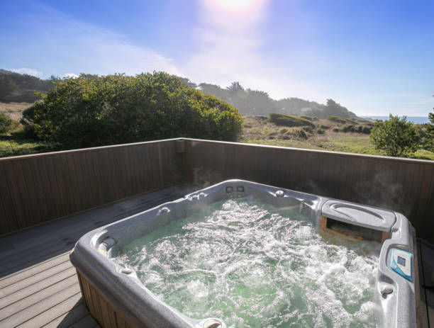 Hot Tub, spa: Outdoors on deck by ocean in California, with no people stock photo