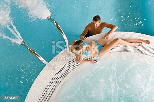 istock Hot tube - young couple relax in swimming pool 153733592