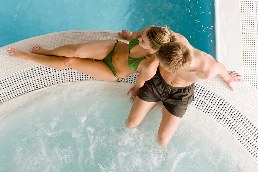 istock Hot tube - young couple relax in swimming pool 153733601