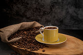 Hot turkish coffee and roasted coffee beans