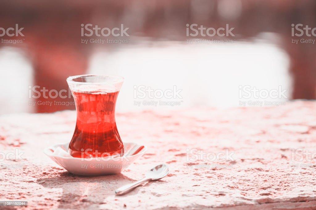 Hot turkish tea outdoors near water. Turkish tea and traditional...
