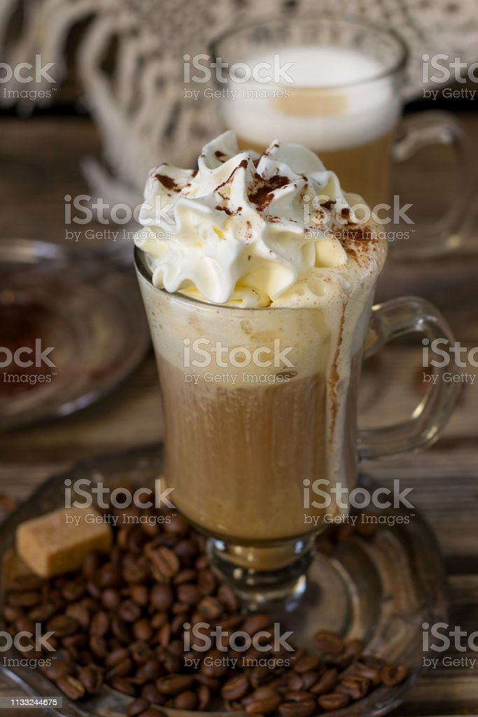 Hot Vienna coffee with whipped cream served with coffee beans