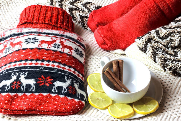 Hot water bottle Hot water bottle with christmas decoration hot water bottle stock pictures, royalty-free photos & images