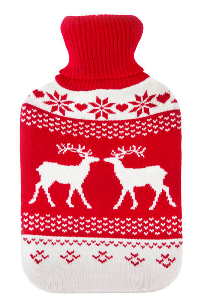 Hot water bottle Hot water bottle against wooden background hot water bottle stock pictures, royalty-free photos & images
