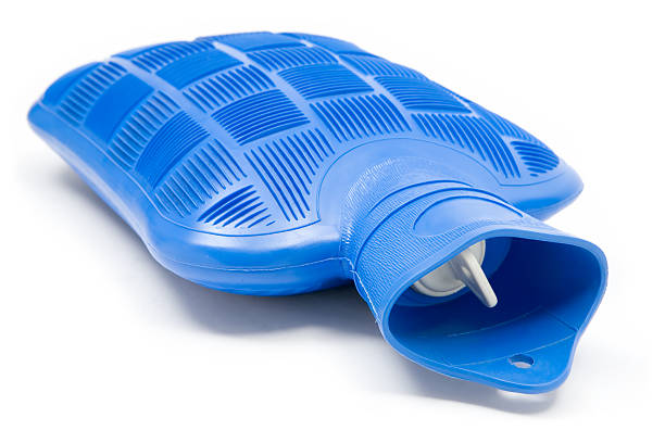 Hot Water Bottle Blue hot water bottle. White background. hot water bottle stock pictures, royalty-free photos & images