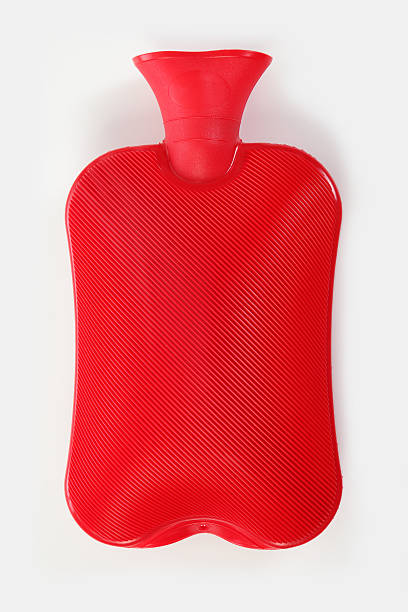 Hot Water Bottle filled, red Hot Water Bottle hot water bottle stock pictures, royalty-free photos & images