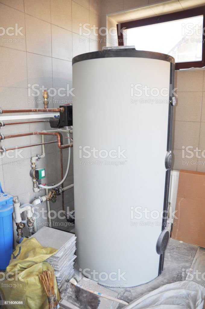 Hot Water Heating Boiler Installation. Condensing Boiler Accumulator Tank. stock photo