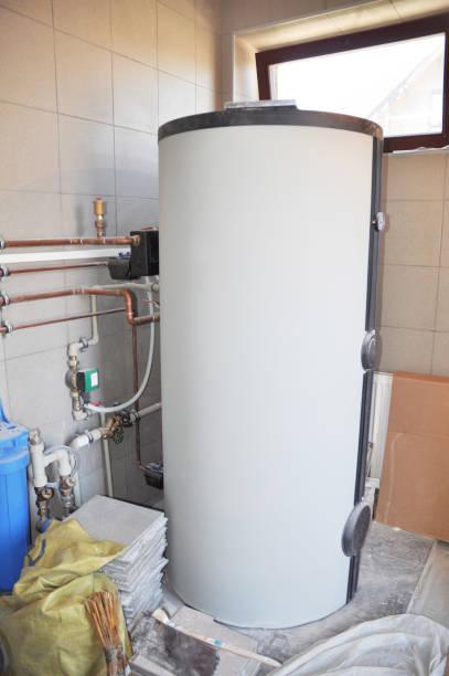 Hot Water Heating Boiler Installation. Condensing Boiler Accumulator Tank. stock photo