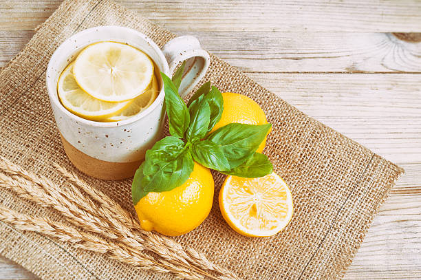 Hot Water with lemon and basil (Vintage faded filter) stock photo